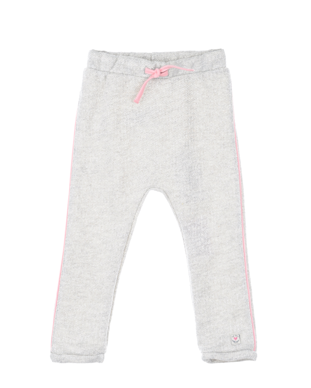 Спортивные брюки с розовыми лампасамиСпортивная одежда<br>Серые спортивные брюки Eat Ants by Sanetta из хлопкового трикотажа с люрексом. Модель прямого кроя с эластичным поясом с розовым шнурком. Брюки декорированы тонкими розовыми лампасами.