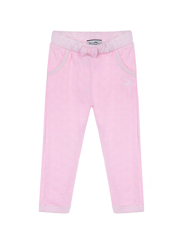 Брюки спортивные Sanetta fiftysevenБрюки<br>Спортивные брюки нежного розового цвета от немецкого бренда SANETTA FIFTYSEVEN. Высококачественный мягкий хлопок в составе изделия отлично пропускает воздух, обеспечивая комфорт в течение всего дня. Эластичная резинка на талии, манжеты и окантовка карманов выполнены из ткани в тонкую розовую и белую полоску. Изделие декорировано объемным текстильным бантом и вышивкой в виде логотипа бренда.