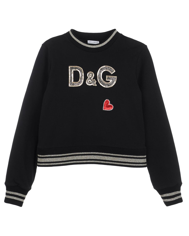 Свитшот Dolce&GabbanaТолстовки, Свитшоты<br>Черный хлопковый свитшот с декоративной отделкой. Стильная модель прямого кроя дополнена контрастными полосами на горловине, манжетах и поясе. Свитшот декорирован пайетками в виде сердца и фирменной монограммой бренда спереди, сзади — патч с названием марки.