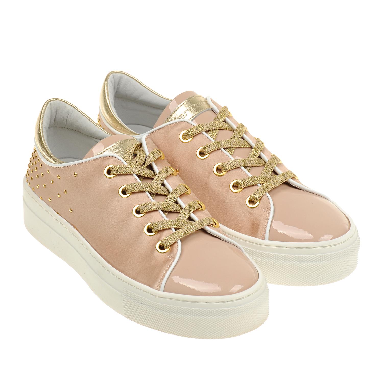 Розовые кеды с золотистыми шнурками