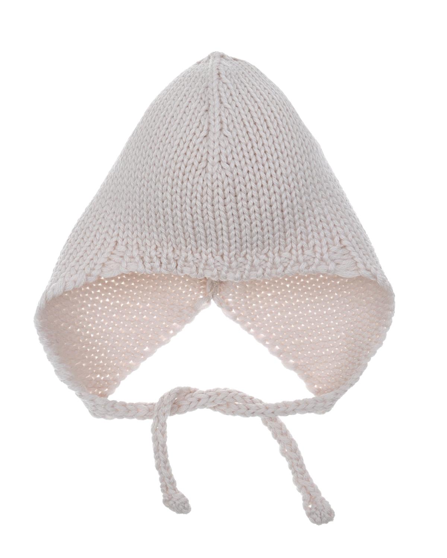 Шапка из шерсти мериноса с завязками KYOШапки<br>Бежевая шапка KYO из ультрамягкой шерсти мериноса. Этот приятный для нежной кожи ребенка материал помогает регулировать теплообмен, поэтому в нём не жарко летом и уютно зимой. Модель фиксируется на голове при помощи узких завязок, которые не дают ей сползать или перекручиваться.
