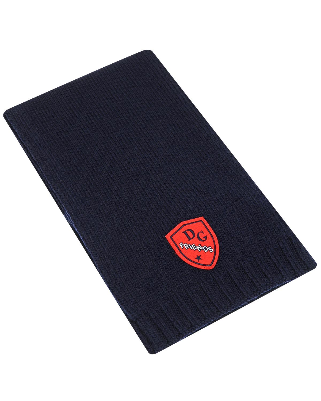 Шарф Dolce&GabbanaШарфы<br>Темно-синий шарф DolceGabbana из чистой шерсти однослойной вязки. Шарф декорирован аппликацией с логотипом.
