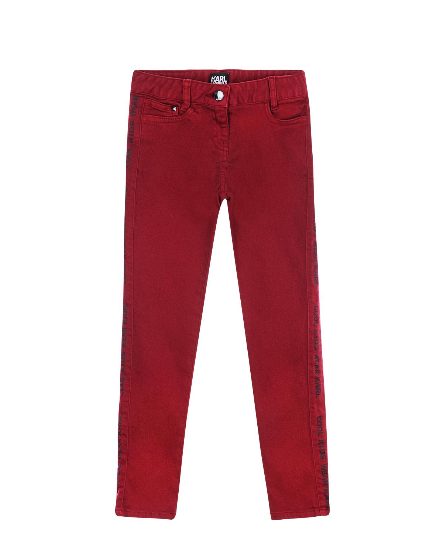 Slim fit джинсы с логотипом по бокам Karl Lagerfeld kidsДжинсы<br>Slim fit джинсы Karl Lagerfeld из бордового денима. Модель «5 карманов» украшена по бокам вставками с логотипом. Пояс дополнен шлевками для ремня.