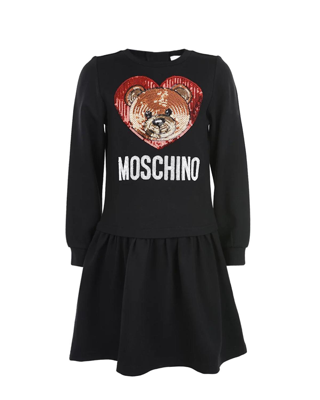Трикотажное платье с вышивкой пайетками MoschinoПлатья, Сарафаны<br>Черное платье Moschino из хлопкового трикотажа. Модель отрезная по талии, с круглым вырезом и длинными рукавами с манжетами. Платье декорировано вышивкой пайетками.